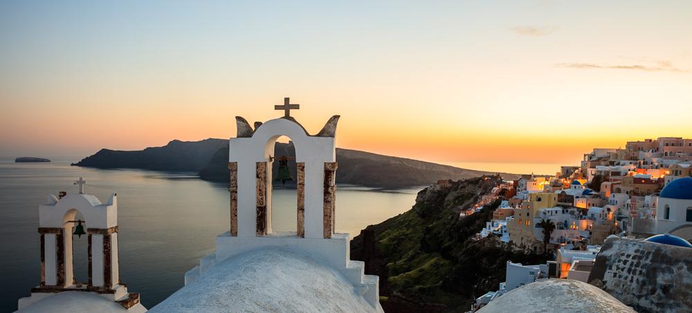 Santorini, Greece - Sunset over Aegean sea and caldera view