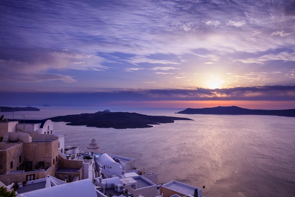 Santorini island, Greece - Beautiful sunset over Aegean sea